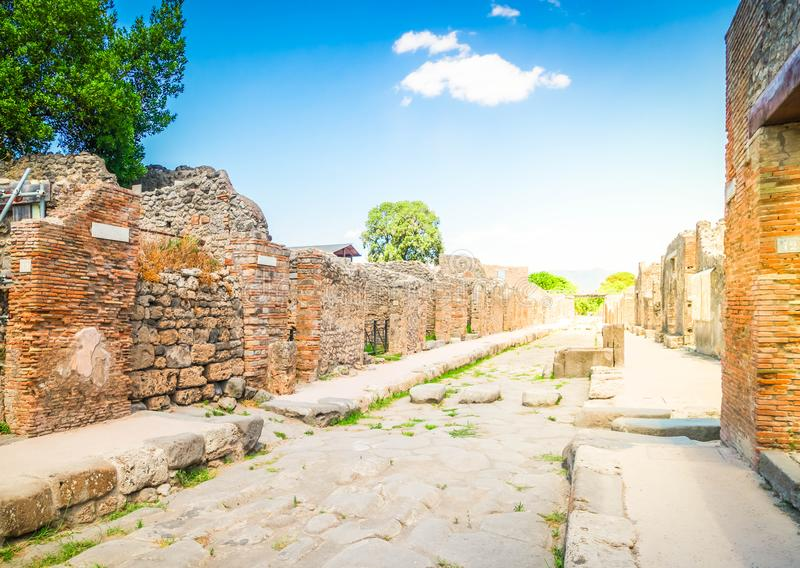 Ruins of Pompeii, Italy. Street of Pompeii with Vesuvius volcano in background, Italy , toned image royalty free stock photography