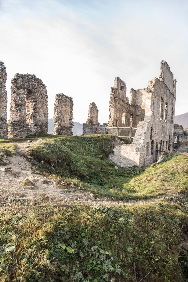 Ruins of Povazsky hrad castle above Povazska Bystrica city in Slovakia. During nice autumn day with blue sky royalty free stock images