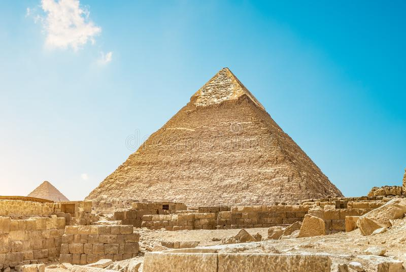 Ruins and pyramid. Ruins near pyramid of Chefren in Cairo, Egypt stock photography