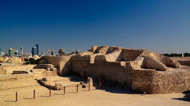 Ruins of Qalat fort and Manama, Bahrain. Ruins of Qalat fort and Manama in Bahrain royalty free stock photos