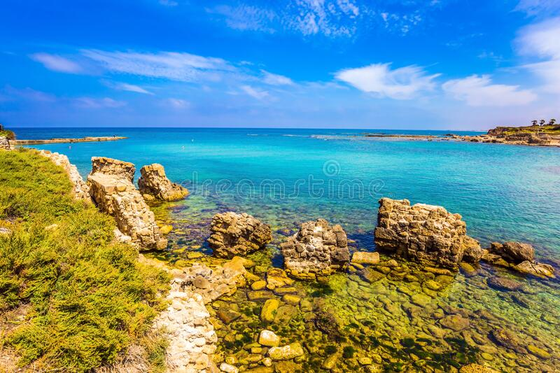 The ruins and remains of ancient fortifications. Ruins of the ancient city and port of Caesarea. Flooded in the sea ruins and remains of ancient fortifications royalty free stock image