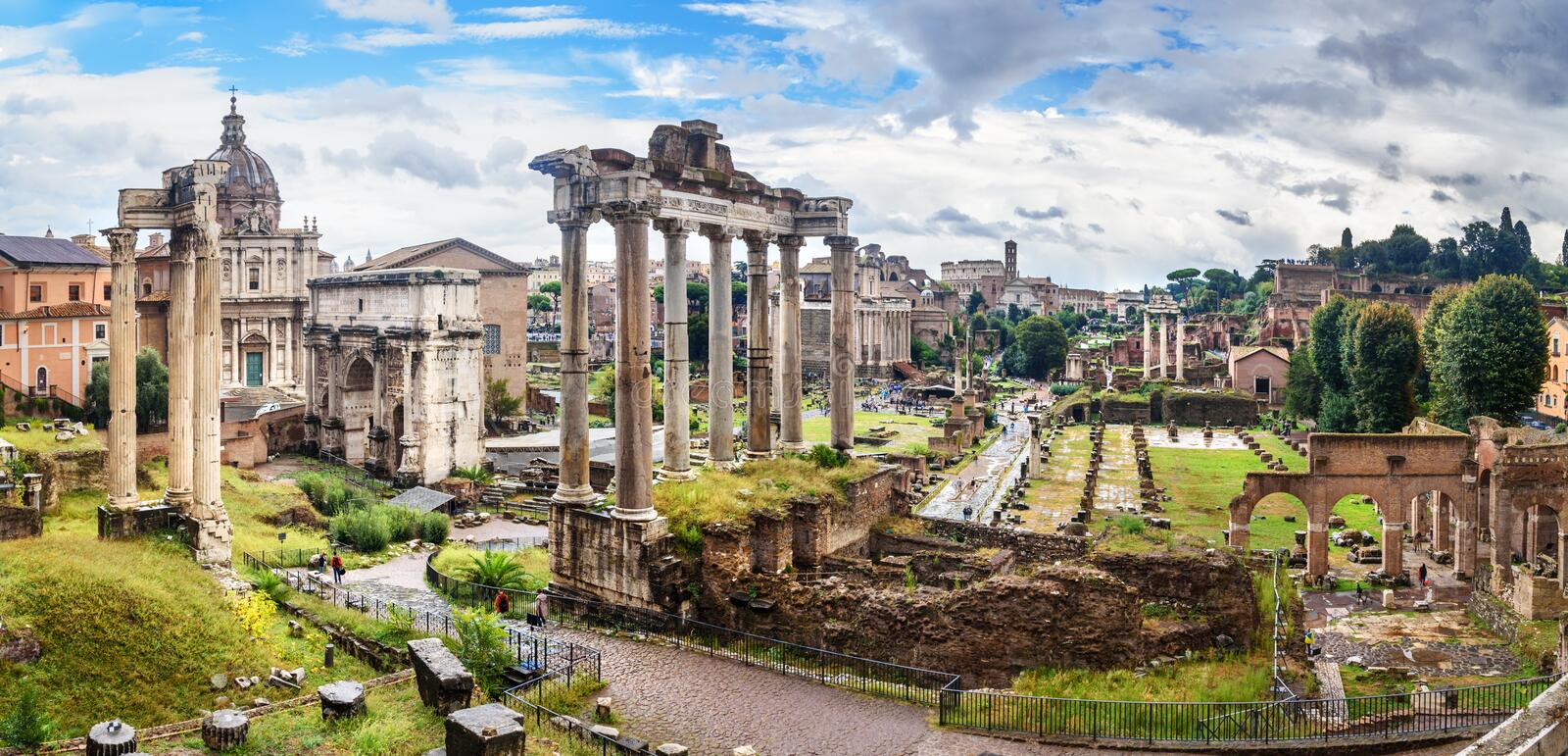 Ruins of Roman Forum. Temple of Saturn, Temple of Vespasian and Titus, Arch of Septimius Severus and others. Rome. Italy. Ruins of Roman Forum. Temple of Saturn royalty free stock photos
