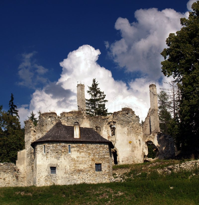 Ruins of Sklabina Castle. And manor house with cloudscape background, Sklabinsky Podzamok, Turiec, Slovakia royalty free stock images