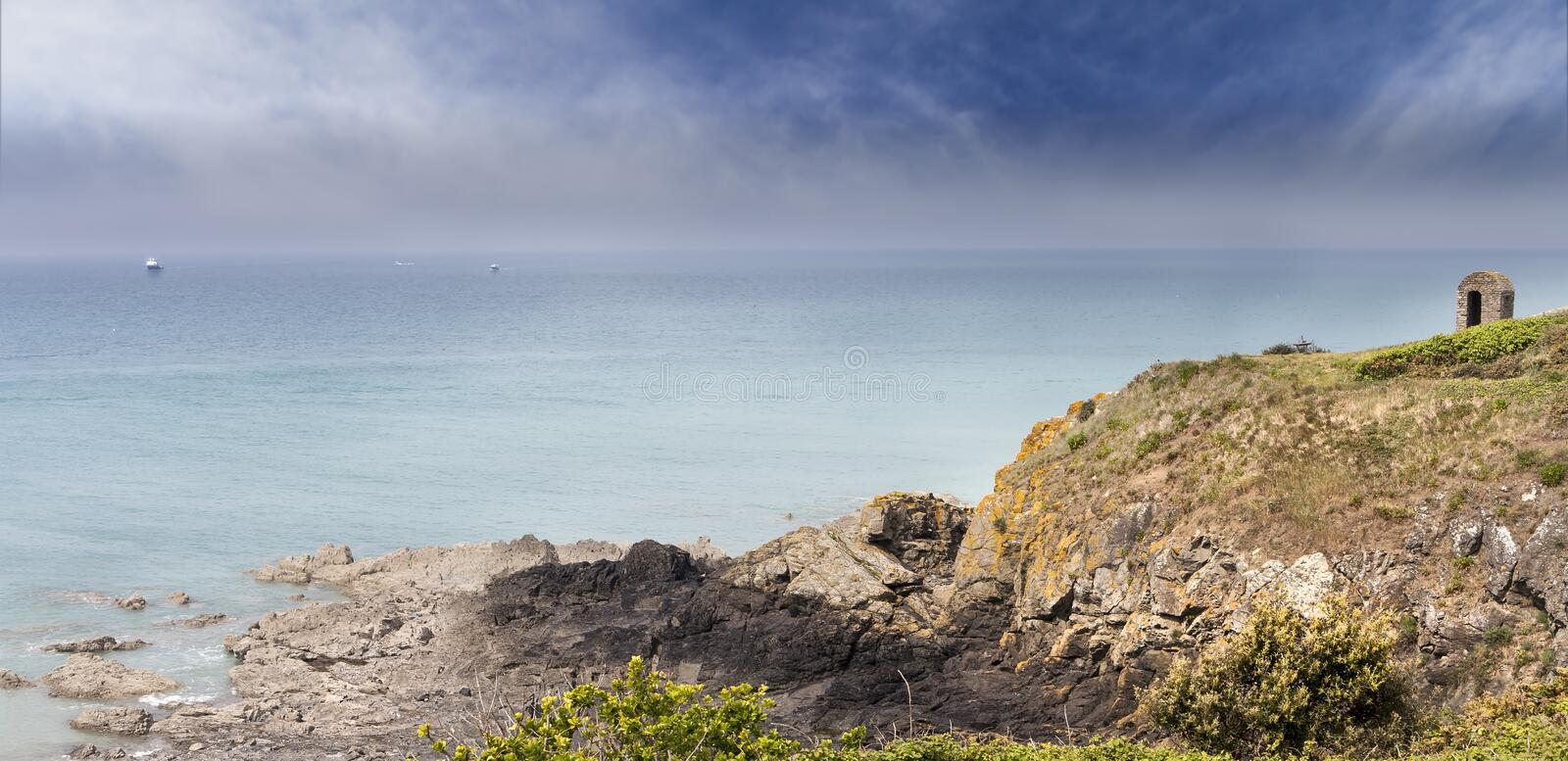 Ruins of a small medieval watchtower coastline near the Atlantic royalty free stock images