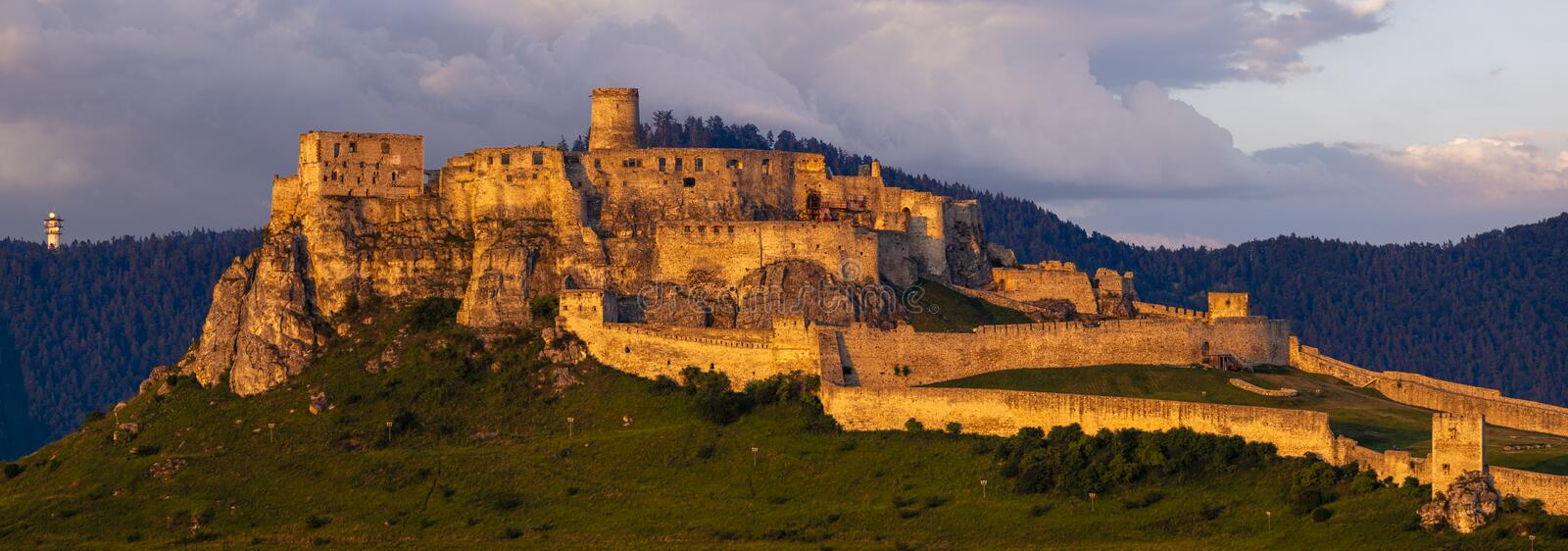 The ruins of the Spissky Castle Spissky hrad, in Slovakia, one of the largest castles in Europe-panorama. The ruins of the Spissky Castle Spissky hrad, in royalty free stock photography