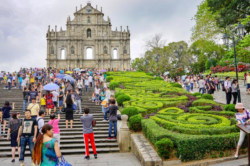 Ruins of St. Paul`s in Macau, lot of tourists. The ruins of St. Paul is a historical monument located in Macau on the territory of the peninsula of the same name royalty free stock photo