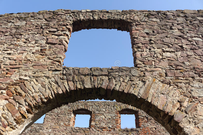Ruins of steelworks. Ruins of nineteen century foundry in Samsonow, Poland on a sunny day. Built with red sandstone. Sunny day perfectly showing hollow windows stock images