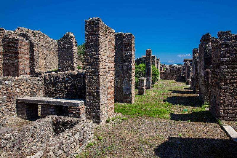 Ruins of the streets and houses in the ancient city of Pompeii. The ruins of the streets and houses in the ancient city of Pompeii royalty free stock image