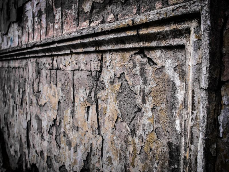 Ruins with stucco molding on old cracked wall. stock photography
