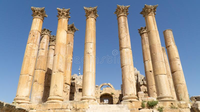 The ruins of the Temple of Artemis situated behind walls of Greco-Roman settlement of Gerasa, Jerash, Jordan royalty free stock image