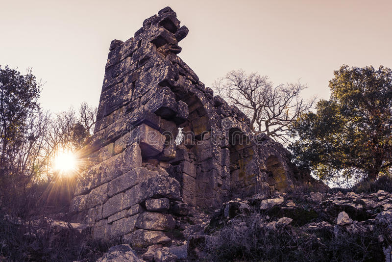 Ruins of Termessos town at sunset in Turkey royalty free stock photos