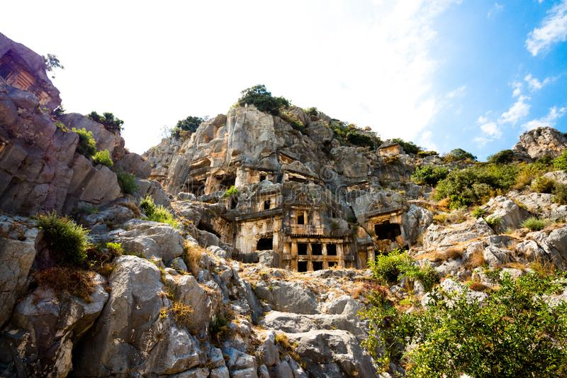 The ruins of the tombs of ancient civilization. Tombs are carved into the rocks on the territory of modern Turkey stock image