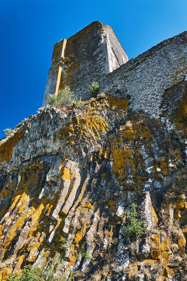 The ruins of the tower of a medieval castle on a rock stock images