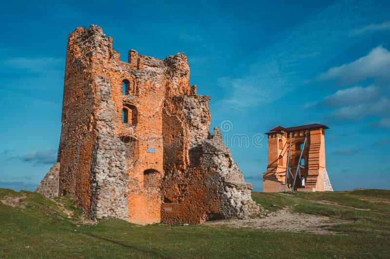 Ruins of Towers and Mindovg Castle on blue sky background in Novogrudok city, Belarus royalty free stock image