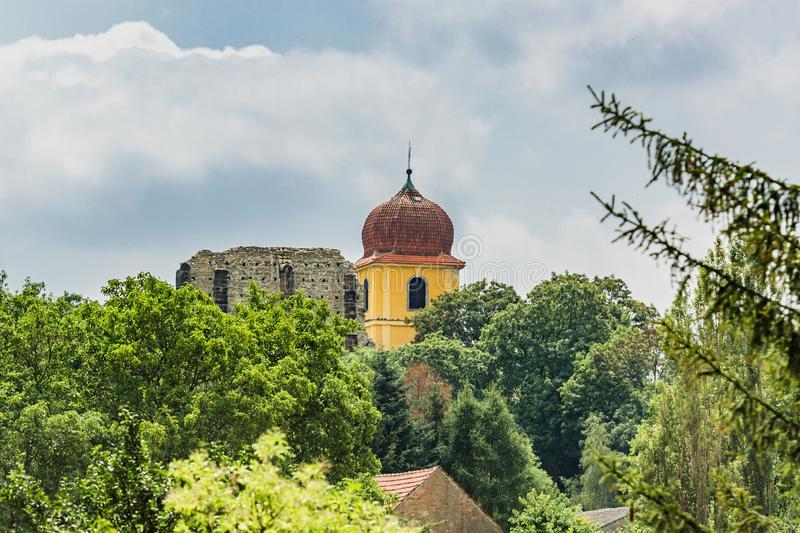 Ruins of the unfinished Gothic church from distance. Panensky Tynec, Czech Republic - July 15 2019: Ruins of the unfinished Gothic church of the Virgin Mary from stock image