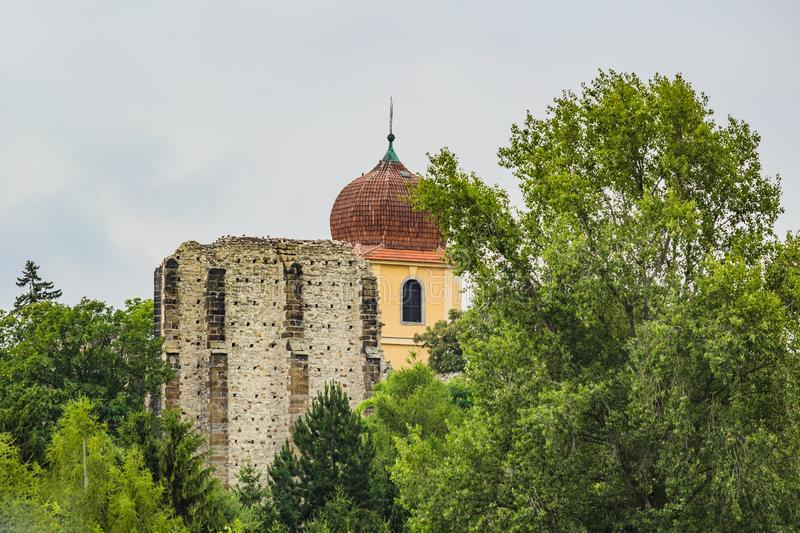 Ruins of the unfinished Gothic church of Virgin Mary from distance. Panensky Tynec, Czech Republic - July 15 2019: Ruins of the unfinished Gothic church of the stock photos
