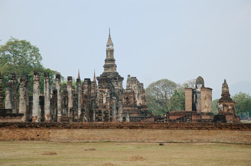 Ruins of unique temples in famous Sukhothai Historical Park. A UNESCO World Heritage Site, Foggy spring day in the ancient 13th and 14th centuries capital of stock images