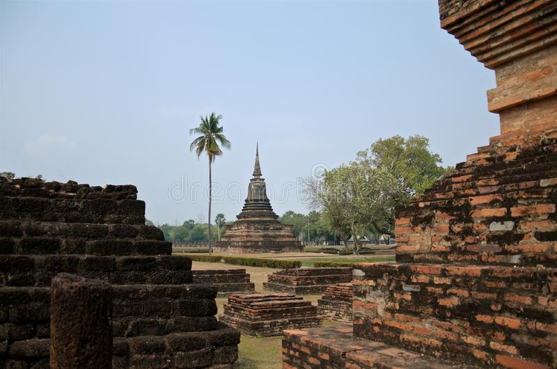 Ruins of unique temples in famous Sukhothai Historical Park, a UNESCO World Heritage Site, Foggy spring day in the ancient 13th. And 14th centuries capital of royalty free stock photo