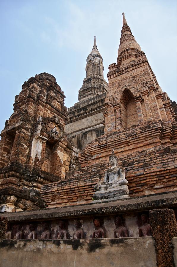 Ruins of unique temples in famous Sukhothai Historical Park, a UNESCO World Heritage Site, Foggy spring day in the ancient 13th. And 14th centuries capital of stock image