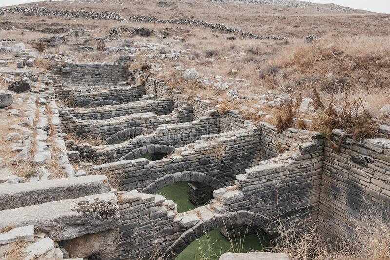 Ruins of a vast reservoir that supplied water on the island of Delos, Greece. An archaeological site near Mykonos in the Aegean Sea Cyclades archipelago stock image