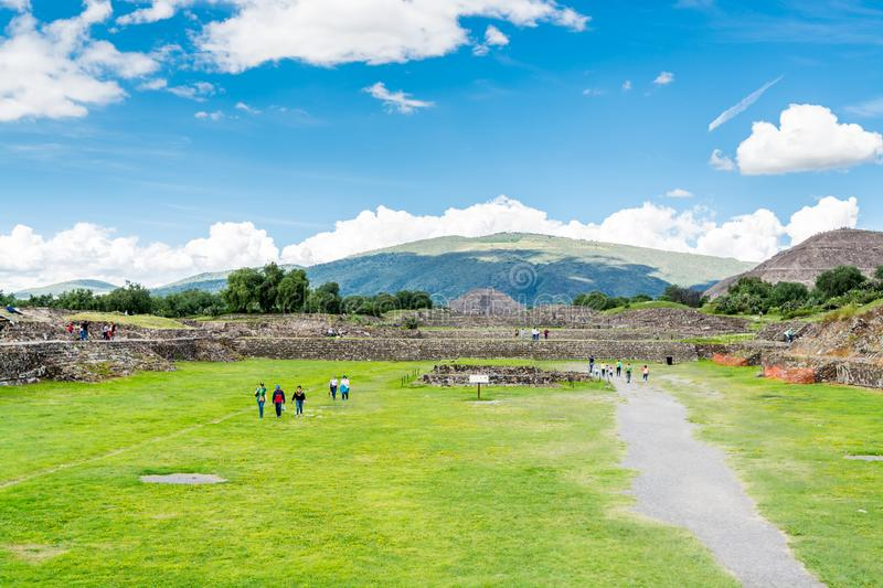 Ruins of the architecturally significant Mesoamerican pyramids and green grassland located at at Teotihuacan, an ancient. Ruins of walls and foundation of the royalty free stock photos