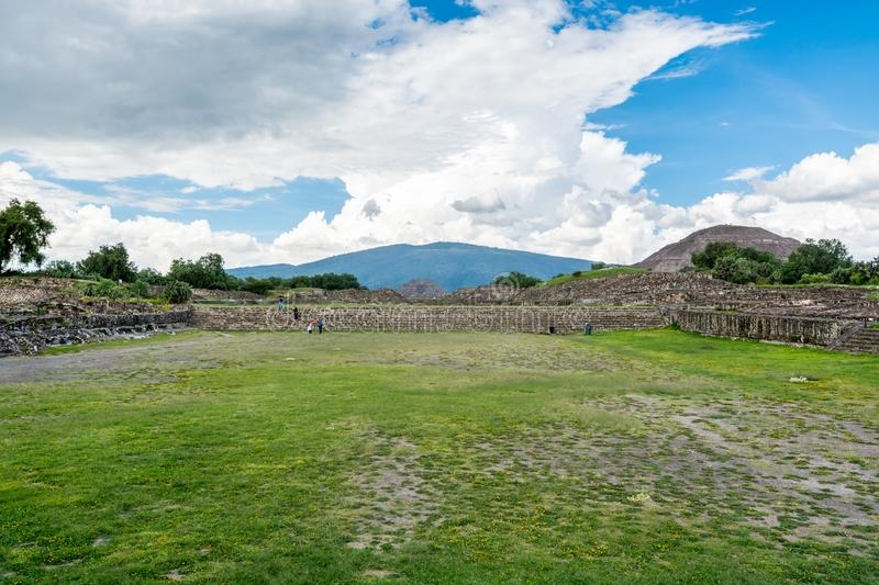 Ruins of the architecturally significant Mesoamerican pyramids and green grassland located at at Teotihuacan, an ancient. Ruins of walls and foundation of the royalty free stock photography