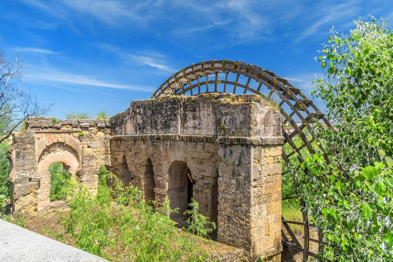 Ruins of watermill with wooden waterwheel in Cordoba, Spain. UNESCO World Heritage Site stock image
