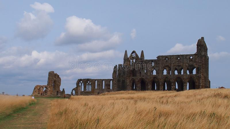 Whitby Abbey in Yorkshire, England. The ruins of Whitby Abbey, a 7th Century monastery on the North Yorkshire Coast in Great Britain stock images