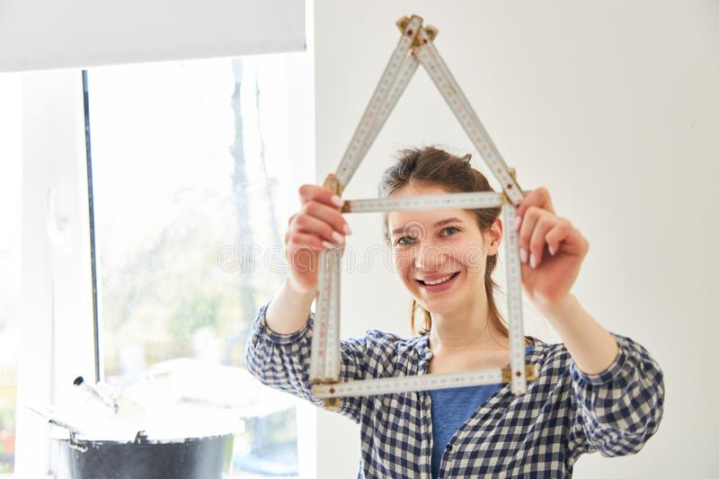 Ruler as a symbol of home construction and home royalty free stock photos
