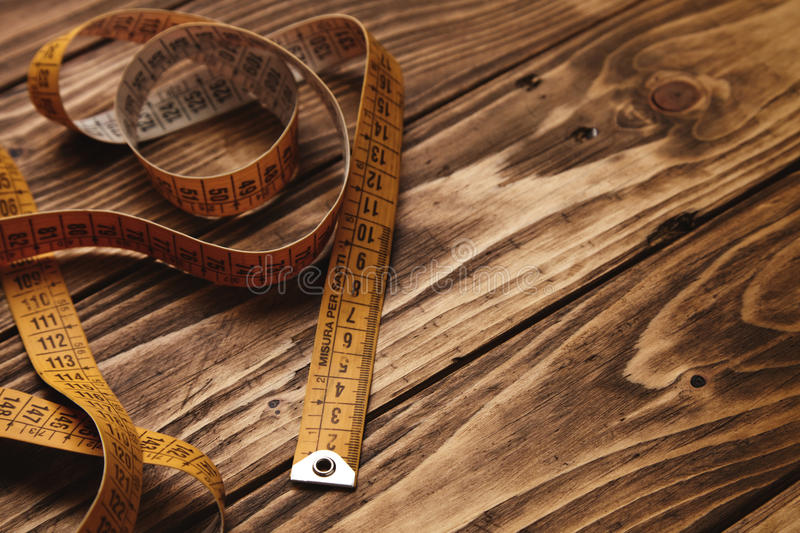 Ruler mockup set. Vintage tailor ruler on rustic wooden table close up royalty free stock photos