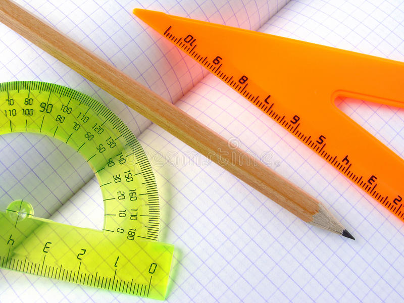 Rulers and pencil. Ruler and angle with pencil on the workbook page stock images