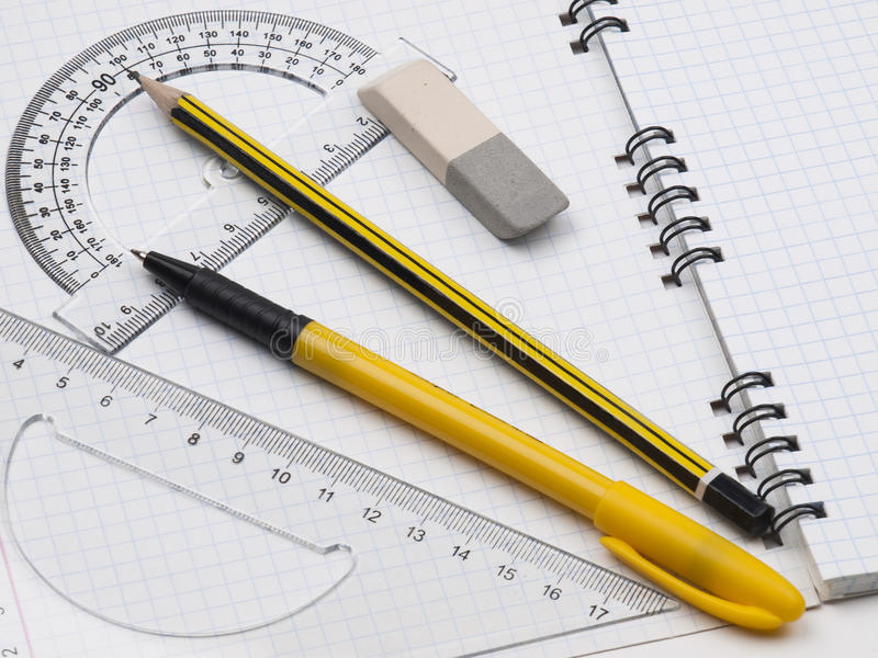 Rulers with pencil on the workbook page. Set of tools for drawing and workbook page stock photography