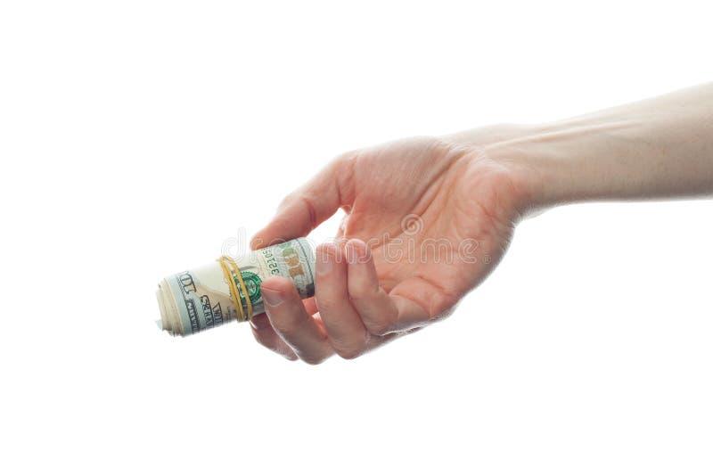 Rullade oss dollar mans in handen som isolerades på vit bakgrund För anmärkningskassa för US dollar 100 pengar royaltyfri foto
