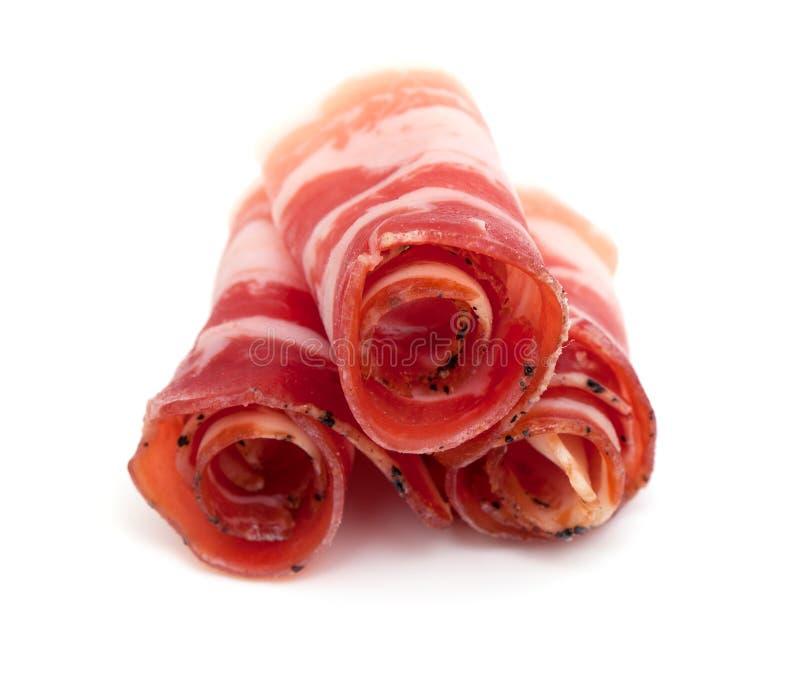 Rullande bacon arkivbild