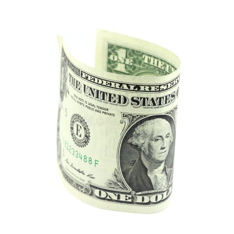 Rullande en dollarräkning arkivbild