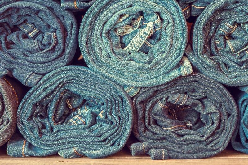 Rullande jeansbakgrund, tonat retro royaltyfri fotografi