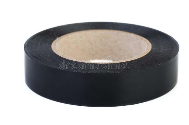 Rulle av det svarta isoleringsbandet arkivfoto