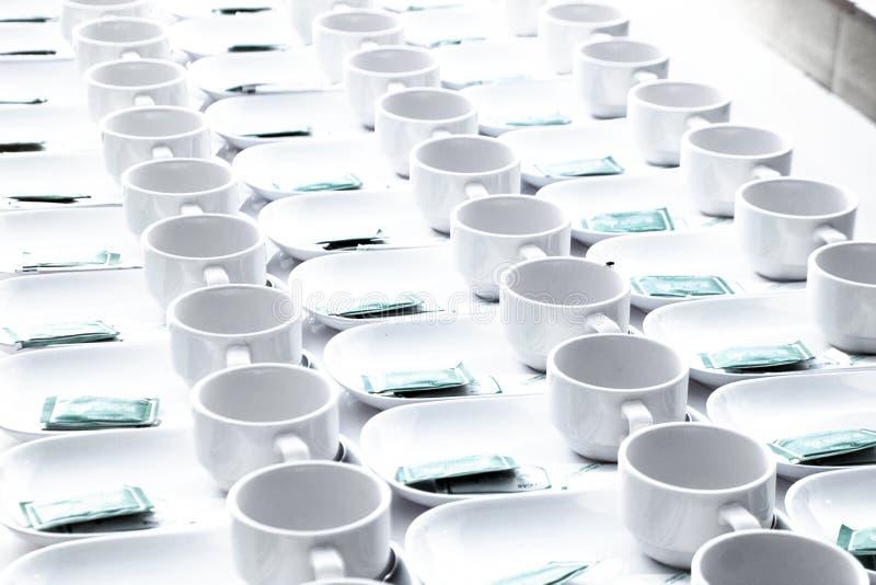 Rulle av kaffekoppen för seminarium fotografering för bildbyråer