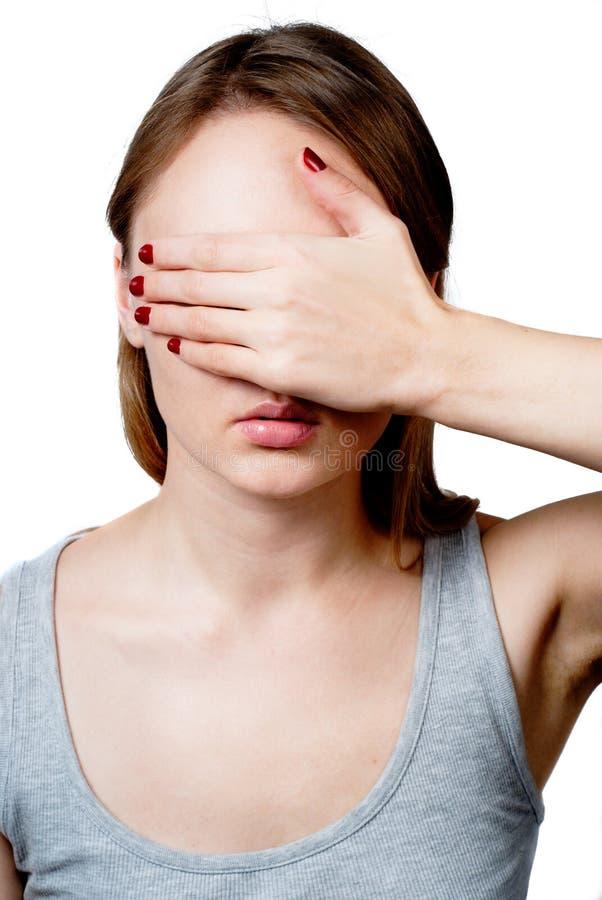 rullgardinen eyes hand henne kvinnan arkivfoto