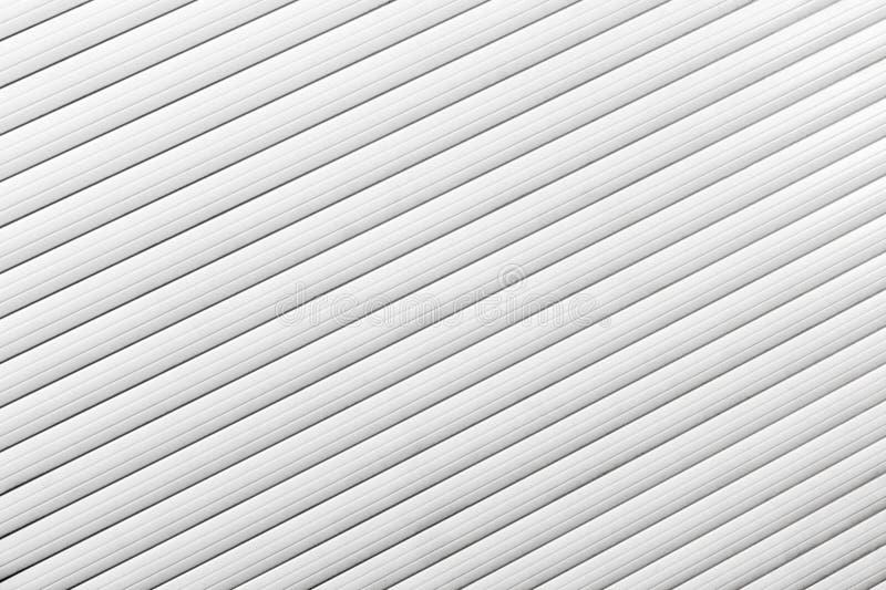Rullgardiner för en vit fönsternärbild royaltyfri foto
