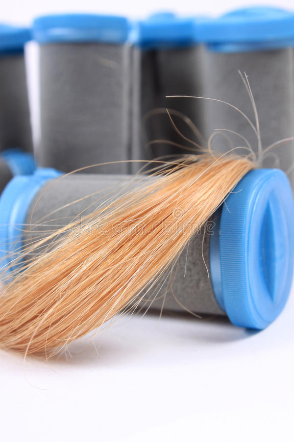 Rulli caldi con capelli biondi immagini stock