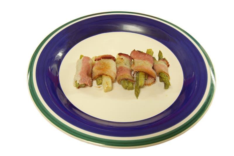 Rullo dell'asparago & della pancetta affumicata cotto fotografia stock libera da diritti