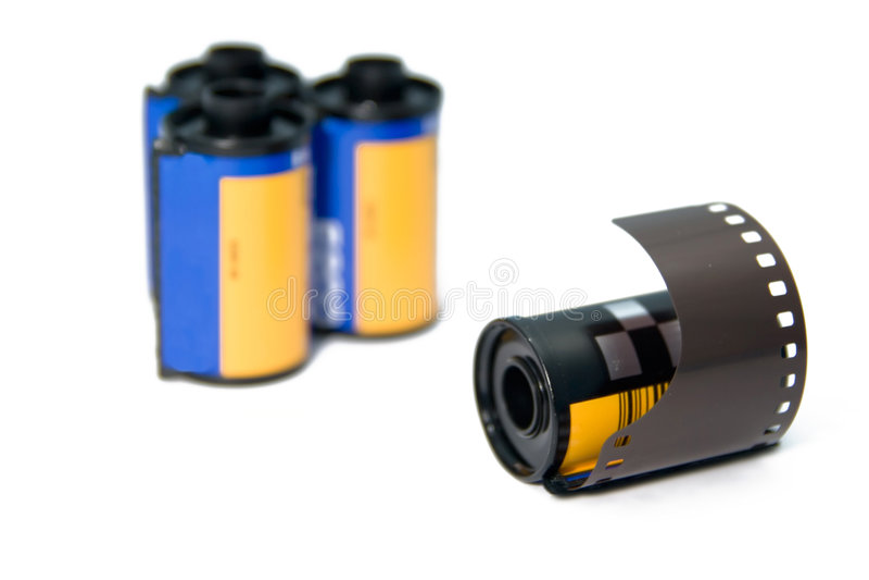 rullo di pellicola di 35mm con i rols di blurrer nei precedenti immagine stock
