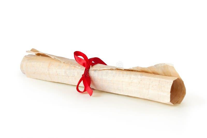 Rullo di pergamena con il nastro fotografie stock
