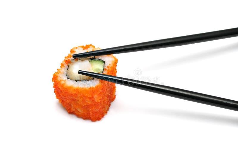 Rullo di sushi e bacchette fotografia stock libera da diritti