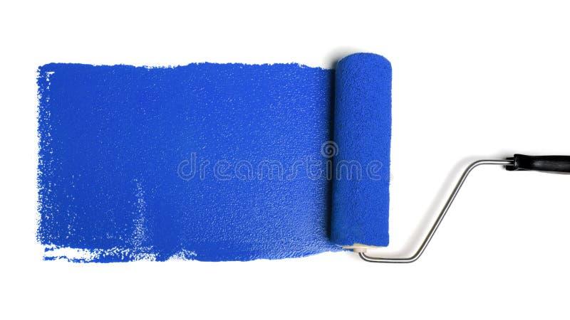 Rullo di vernice con vernice blu fotografia stock libera da diritti