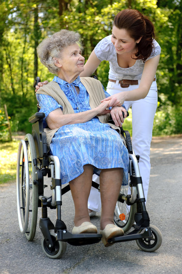 rullstolkvinna royaltyfri foto