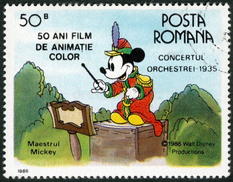 RUMÄNIEN - 1986: shower Mickey Mouse, Walt Disney tecken i musikbandkonserten, 1935 som ägnas femtio år av färg animerade filmer stock illustrationer