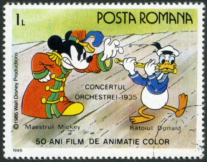 RUMÄNIEN - 1986: Shows Mickey und Donald, Walt Disney-Charaktere in der Band Concert, 1935, fünfzig Jahre Farbzeichentrickfilme lizenzfreie abbildung