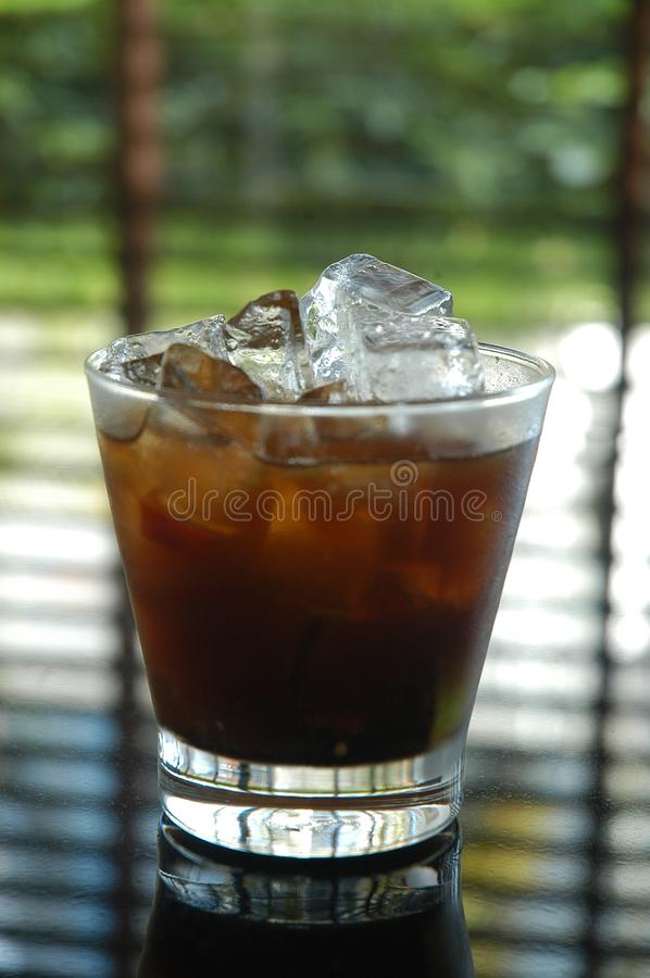 Rum and Coke with ice stock image